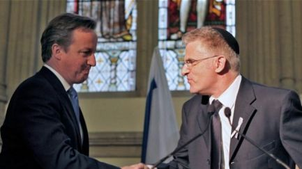 Prime Minister David Cameron shaking hands with Israeli regime's agent in Britain, Daniel Taub.