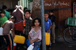 Palestinian children store water