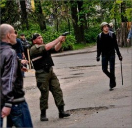 Fascists-firing-on-citizens-at-the-trade-union-builidng-in-Odessa-on-May-2-2014-300x291