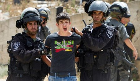 Palestinian-youth-arrested-by-Israeli-soldiers-in-Beit-Hanina