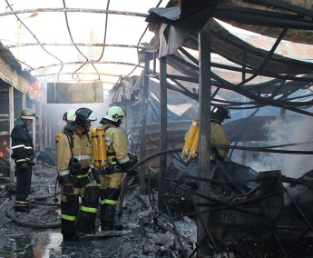 2637716 06/06/2015 Firemen extinguish fire at the Oktyabrksy market caused by a shell hit during the shelling of Donetsk. Irina Gerashchenko/RIA Novosti