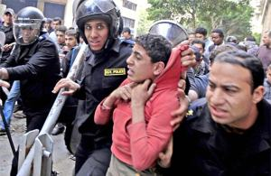 egyptian-protestor-getting-arrested-teenager
