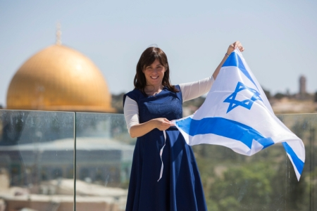 Portrait of Likud parliament member Tzipi Hotovely, holds the Israeli flag with the Dome of the Rock behind her on May 1, 2014. Photo by Yonatan Sindel/Flash90 *** Local Caption *** ????? ??? ????? ?????? ???? ???????