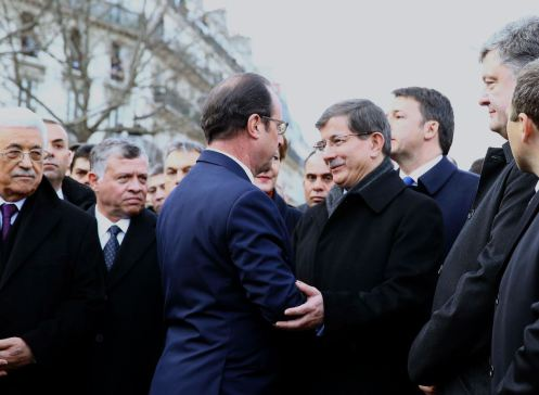 PARIS, FRANCE - JANUARY 11: Turkish Prime Minister Ahmet Davutoglu (center R) talks to French President Francois Hollande (center L) during the Unity March 'Marche Republicaine' in Paris, France on January 11, 2014. (Photo by Hakan Goktepe/Anadolu Agency/Getty Images)