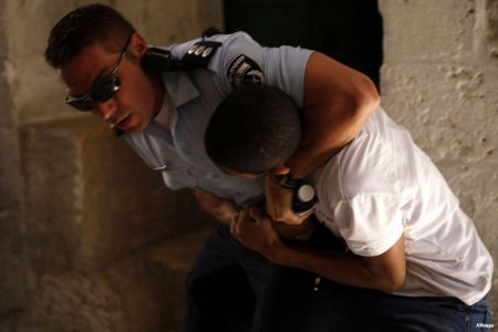 Palestinian-youth-arrested-by-Israeli-soldiers-in-al-aqsa-mosque04