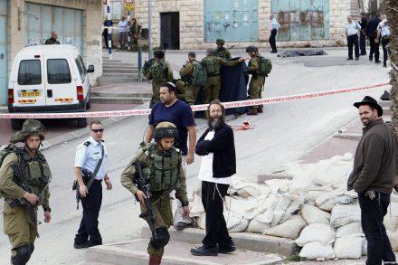 settlers-look-on-in-aftermath-of-Abdel-Fattah-Al-Sharif-killed-hebron-March-24-2016